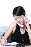 Business woman working with telephone Royalty Free Stock Images