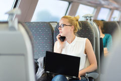Business woman working while travelling by train. Royalty Free Stock Photos