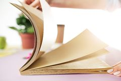 The business woman in the workplace flips through the dailybook. The business woman in the workplace flipping through the dailybook. Side view on woman on trendy Royalty Free Stock Photography