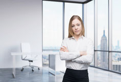 A business woman in a workplace at modern panoramic office in New York, Manhattan. A concept of financial consulting ser Royalty Free Stock Images