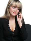 Business woman on the workplace talks by the phone Royalty Free Stock Image
