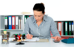 Business woman at workplace Stock Images