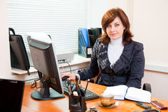 Business woman works. Business woman portrait in an office Royalty Free Stock Photography