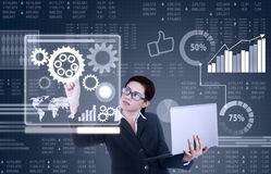 Business woman works with business interface Stock Photography