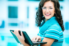 Business woman works on laptop Royalty Free Stock Photo