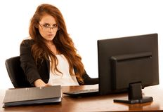 Business woman works in the office checking database on computer Stock Photography