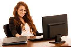 Business woman works in the office checking database on computer Royalty Free Stock Images
