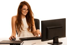 Business woman works in the office checking database on computer Royalty Free Stock Photos
