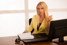 Business woman works in the office with computer - happy secreta Stock Photo