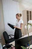 Business woman works in office. Royalty Free Stock Image