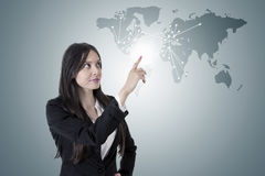 Business woman. With the world map royalty free stock photo