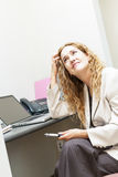 Business woman worried at office desk Royalty Free Stock Photos