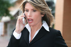 Business Woman Worried Shocked on Cellphone Stock Image