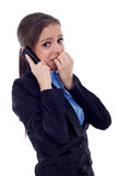 Business woman worries on the phone Royalty Free Stock Photo