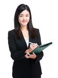 Business woman write on clipboard Royalty Free Stock Photography