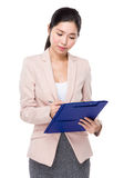 Business woman write on clipboard Royalty Free Stock Images