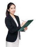 Business woman write down on clipboard Royalty Free Stock Photo