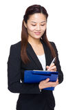 Business woman write something on file pad Stock Images