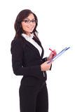 Business woman writes on clipboard Royalty Free Stock Images