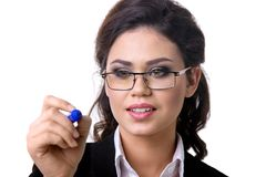 Business woman writes marker on glass. A Business woman writes marker on glass Royalty Free Stock Image