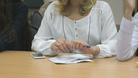 Business woman writes in notepad at the conference stock footage