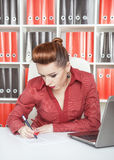Business woman writing Stock Image