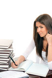 Business Woman Writing And Talking On Phone Stock Image