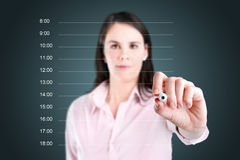 Business woman writing blank appointment schedule. Royalty Free Stock Photos
