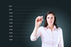 Business woman writing blank appointment schedule. Royalty Free Stock Images