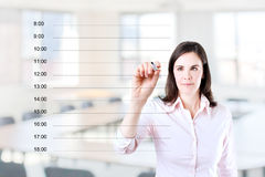 Business woman writing blank appointment schedule Stock Photo