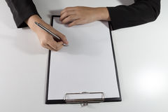Business woman writing in blank paper Royalty Free Stock Photos