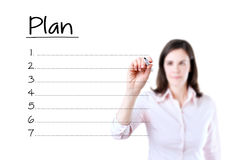 Business woman writing blank plan list. Isolated on white. Royalty Free Stock Photos