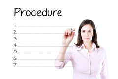 Business woman writing blank procedure list. Isolated on white. Royalty Free Stock Images