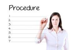 Business woman writing blank procedure list. Isolated on white. Business woman writing blank procedure list. Isolated on white Stock Photography