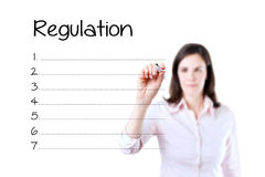Business woman writing blank regulation list. Isol Royalty Free Stock Photos