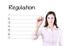 Business woman writing blank regulation list. Isolated on white. Business woman writing blank regulation list. Isolated on white Stock Photos