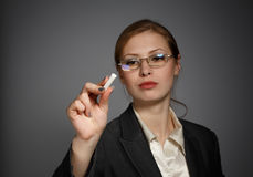 Business woman writing with chalk royalty free stock images
