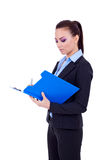 Business woman writing on a clipboard Stock Image