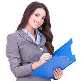 Business woman writing on clipboard Royalty Free Stock Images