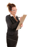 Business woman is writing in document Stock Photo