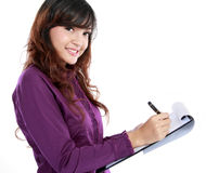 Business woman writing on document Stock Images