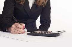 Business woman. Writing on a document Stock Image