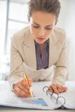 Business woman writing in document Stock Image