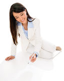 Business woman writing on the floor Royalty Free Stock Images