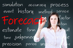 Business woman writing forecast concept. Blue background. Royalty Free Stock Image