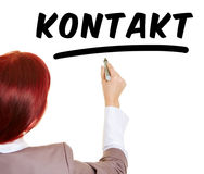 Woman writing word Kontakt with pen Royalty Free Stock Photos