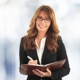 Business woman writing in her notebook royalty free stock photo