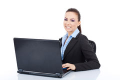 Business woman writing on a laptop Stock Images