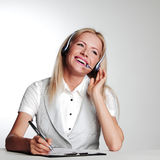 Business woman writing in notebook Stock Image