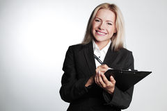 Business woman writing in notebook Royalty Free Stock Photos